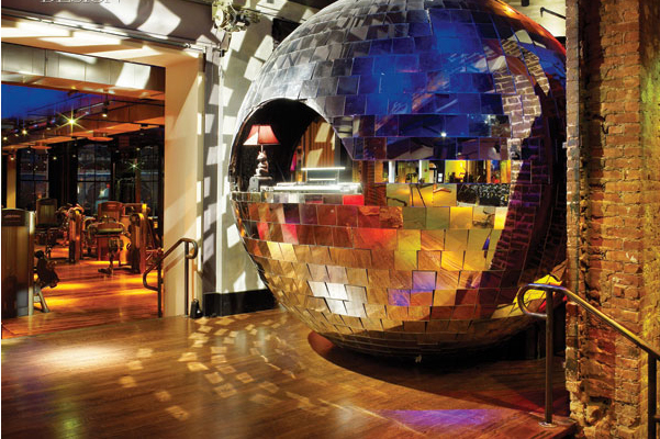 354787-using_a_torch_to_cut_a_semicircular_opening_in_a_disco_ball_transformed_it_into_a_dj_booth_photo_by_eric_laignel_1
